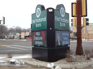 Custom corner sign structure incorporating 3 Daktronics displays for 360 degree viewing