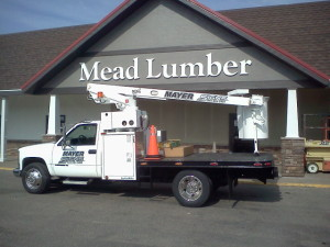 Custom lettering and Mayer Signs bucket truck